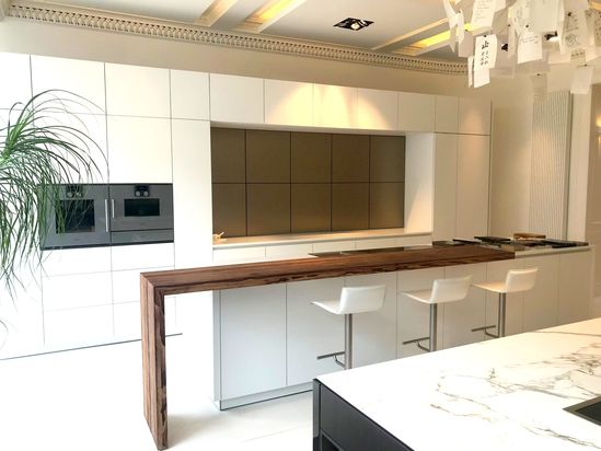 More click [...] Kitchen Island With Breakfast Bar Shaped Ex Display Warendorf Opaque White Kitchen Island Breakfast Bar Corian Worktops And Gaggenau Appliances The Used Kitchen Company The Used Kitchen Company Ex Display Warendorf Opaque White ...