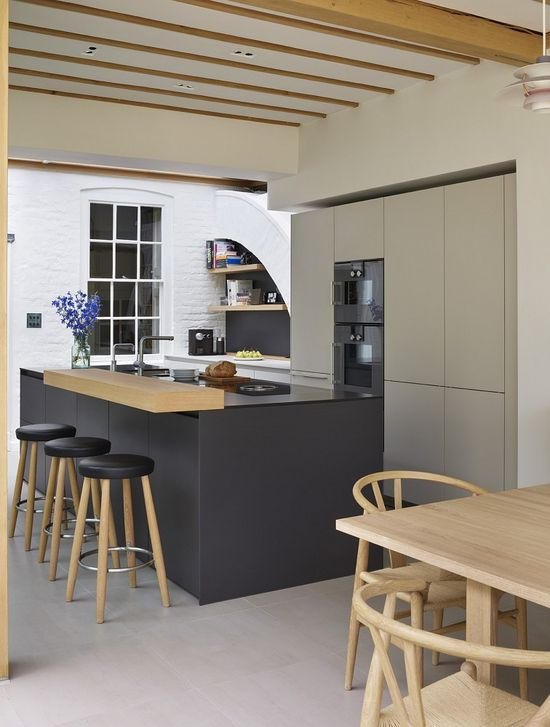 Kitchen Architecture- bulthaup b3 furniture in graphite and gravel with a oak bar.